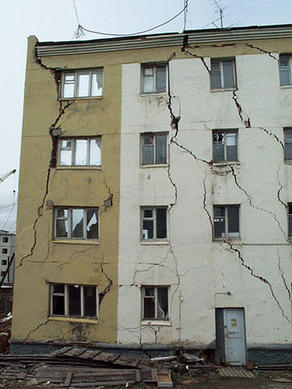 An apartment building in Chersky, Russia (lower Kolyma River) partially destroyed by thawing icy permafrost under one of its section.