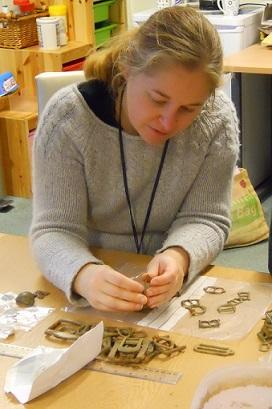 A PAS Finds Liaison Officer studying finds