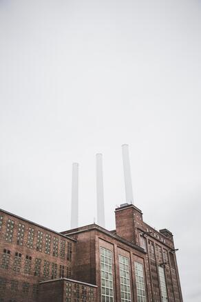 Factory chimneys in foggy weather