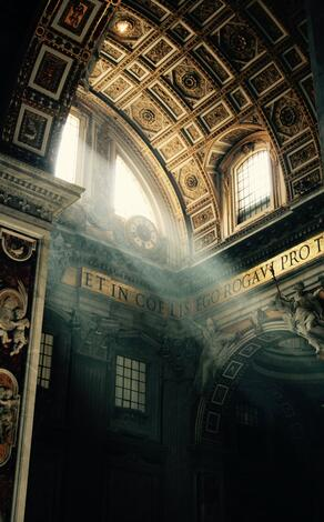 St. Peter's Basilica's insides with light coming from the window.