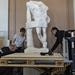 The careful transfer of sculptures requires expertise. Vesa Hokkanen and Tapani Huovinen of Beweship Fine Art Logistics and conservator Anna Lehtinen moving the lower part of the Resting Satyr.