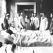 Professor Johan Wilhelm Runeberg teaching on a ward round in the New Clinic in the year 1893. This is probably the oldest photo of Finnish doctors wearing white coats. Photo by unknown photographer.