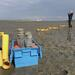 Iines and Karo performing in situ isotope labeling experiments during ebb tide on an intertidal mudflat of the Dutch Wadden Sea. © IS / ABRU