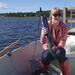 Soila excited to use the YSI sonde for temperature and oxygen profiling in lake Kymijärvi, southern Finland, to monitor the lake´s density stratification and water oxygen content. © J. Horppila / HU