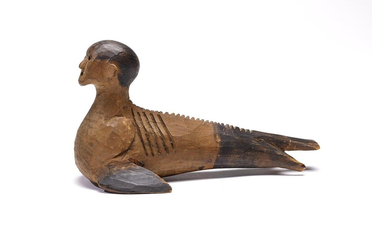 Wooden human-bird figure.
