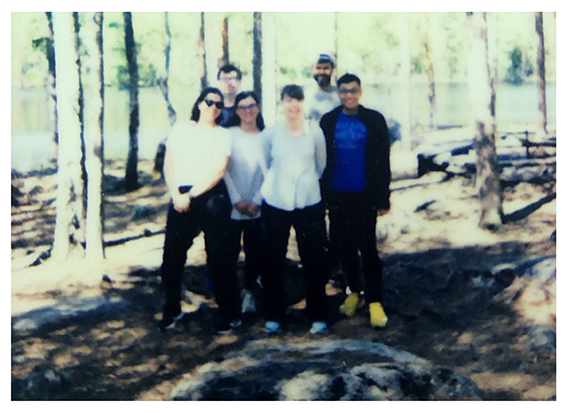Polaroid of the TRIM group members hiking in 2021