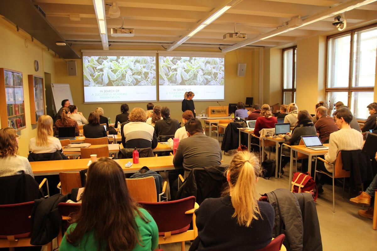 Winter School 2020 participants listening to a lecture in the Common room of the Collegium