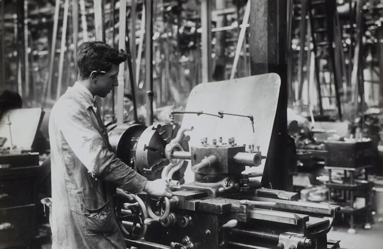 Black and white image of a factory worker