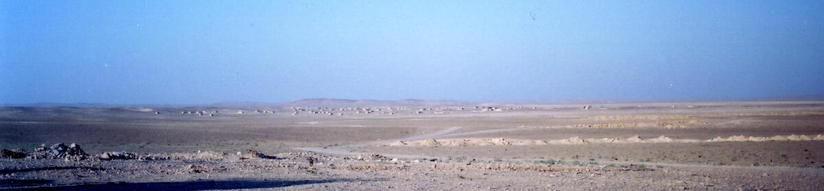 A panorama of the Bedouing village of Shanhas, a semi-sedentarism on the western piedmont of Jebel Bishri in Central Syria. Photo: Minna Lönnqvist (Silver) 2000.