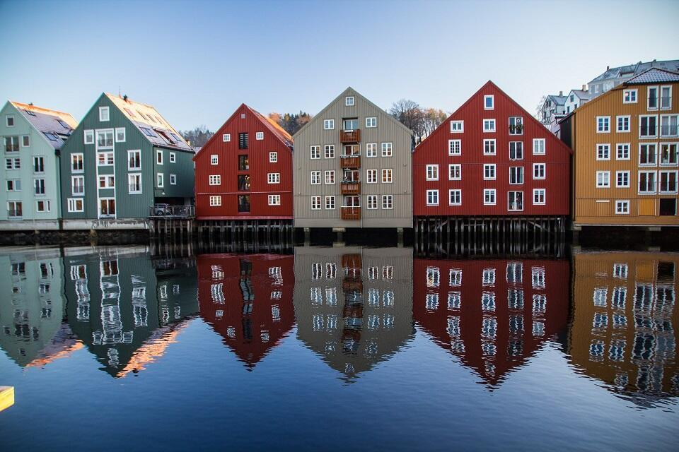 Row of colorful houses in Trondheim. Photo by Simon Williams on Unsplash.