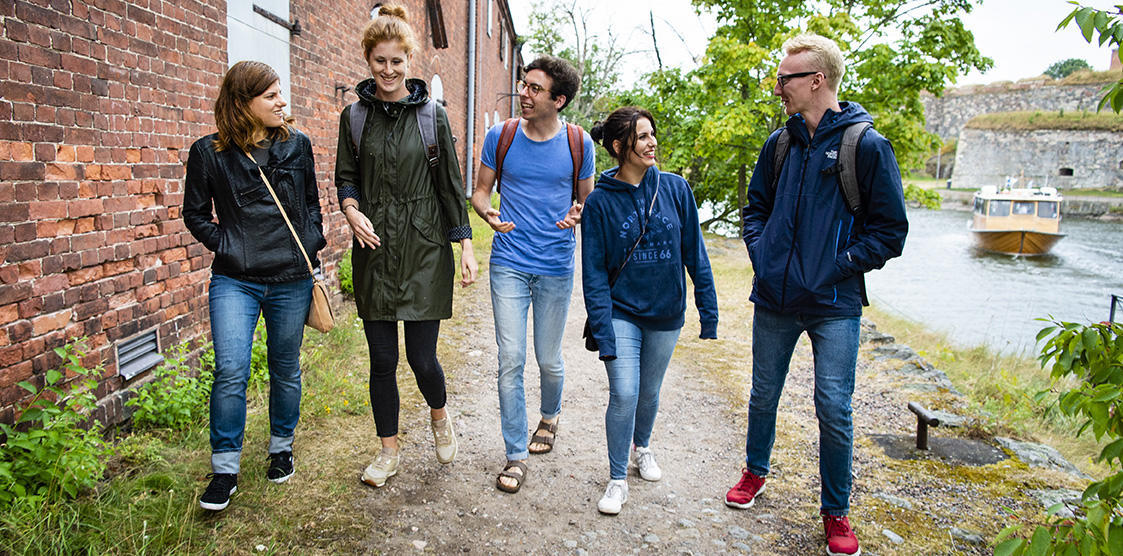 Helsinki Summer school picture of student by a river side