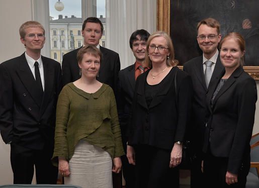 Photo of Anneli Aejmelaeus and her research group after her inaugural lecture in 2009. The venue is the Main Building of the University of Helsinki.