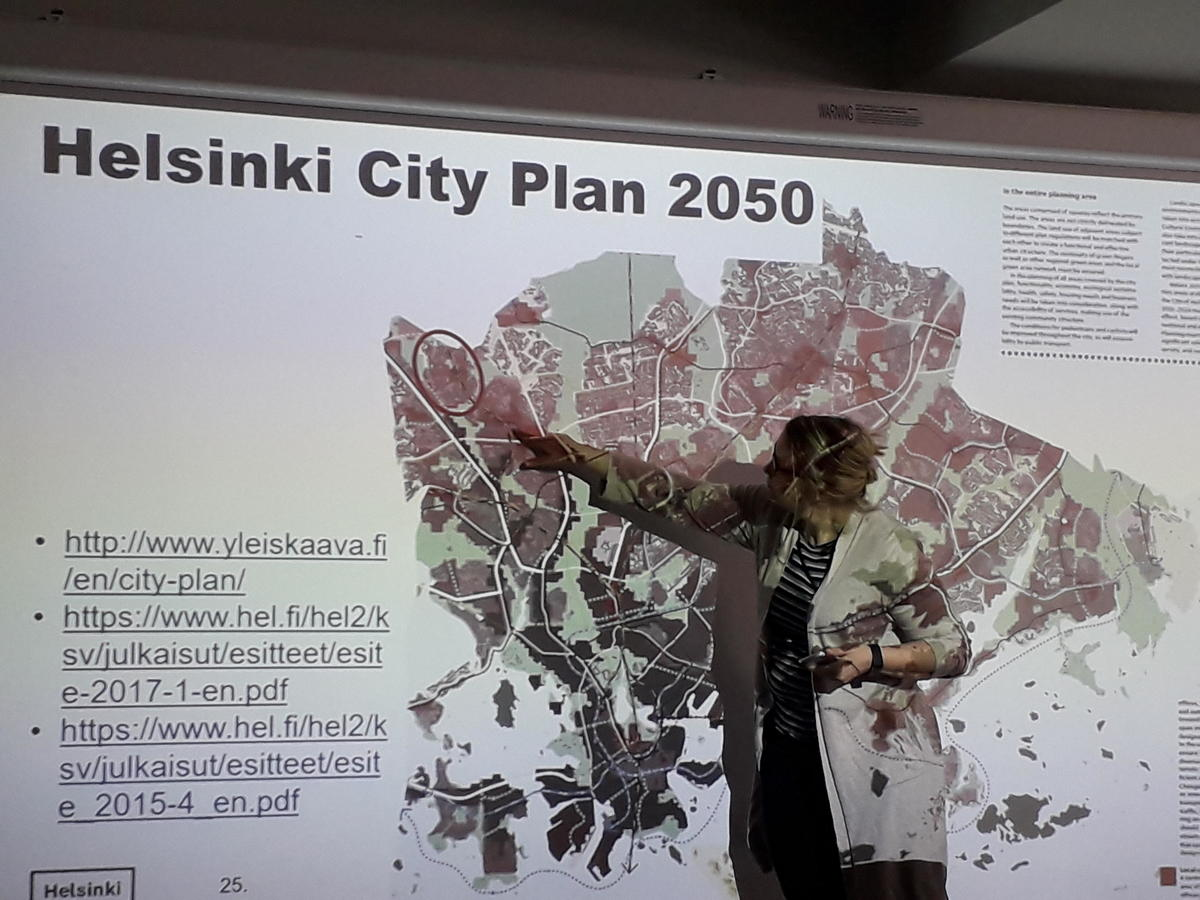 Photo of Project Director Ulla Loukkaanhuhta from the City of Helsinki/Urban Development presenting the case area.