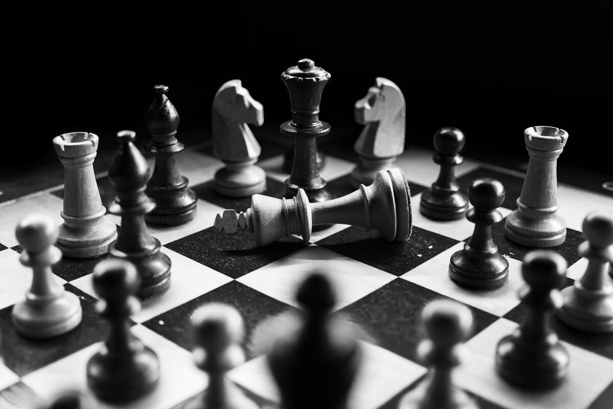 A game of chess in black and white.