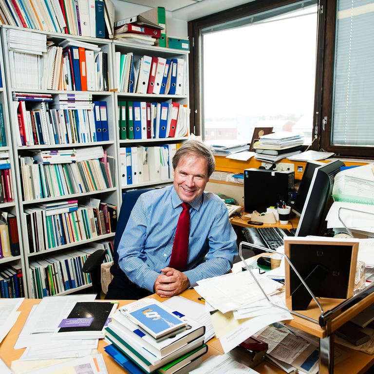 Researcher sitting in his room: University of Helsinki highly cited researchers.