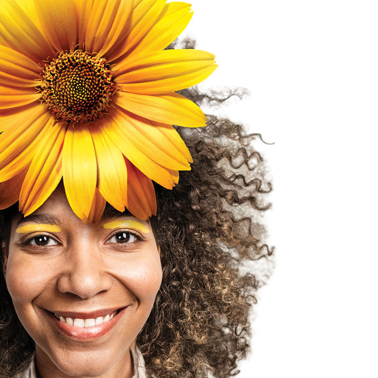 A girl with a sun flower in her hair represents the spirit of the Helsinki Summer School.