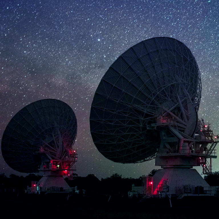 Radiotelescopes in a starry night.
