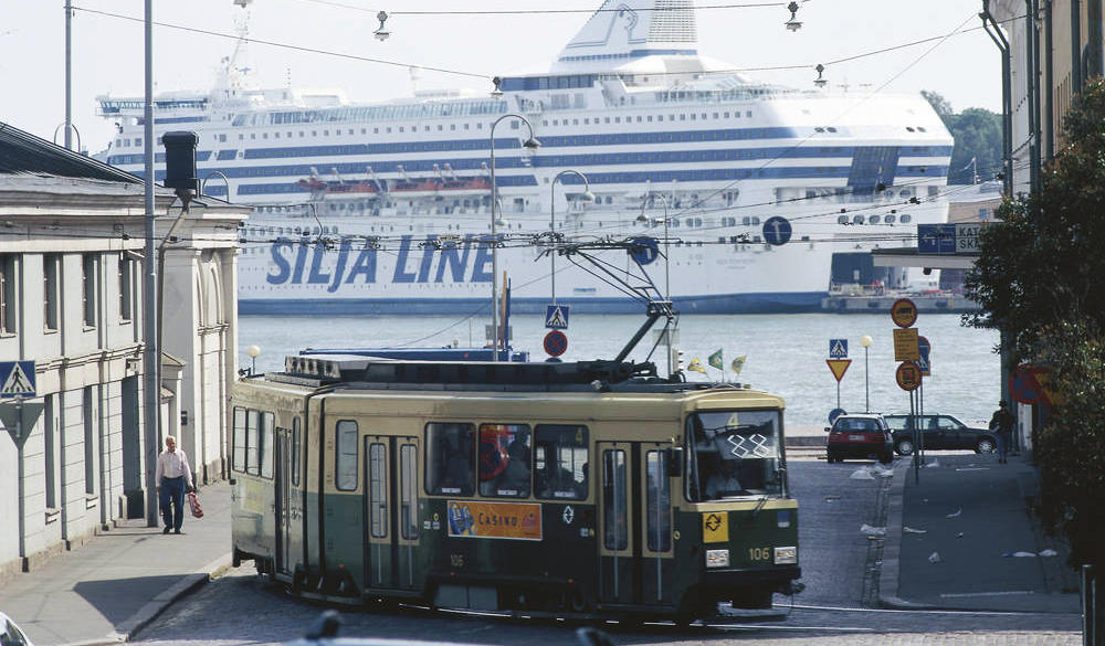 Helsinki street view with a ferry and a tram