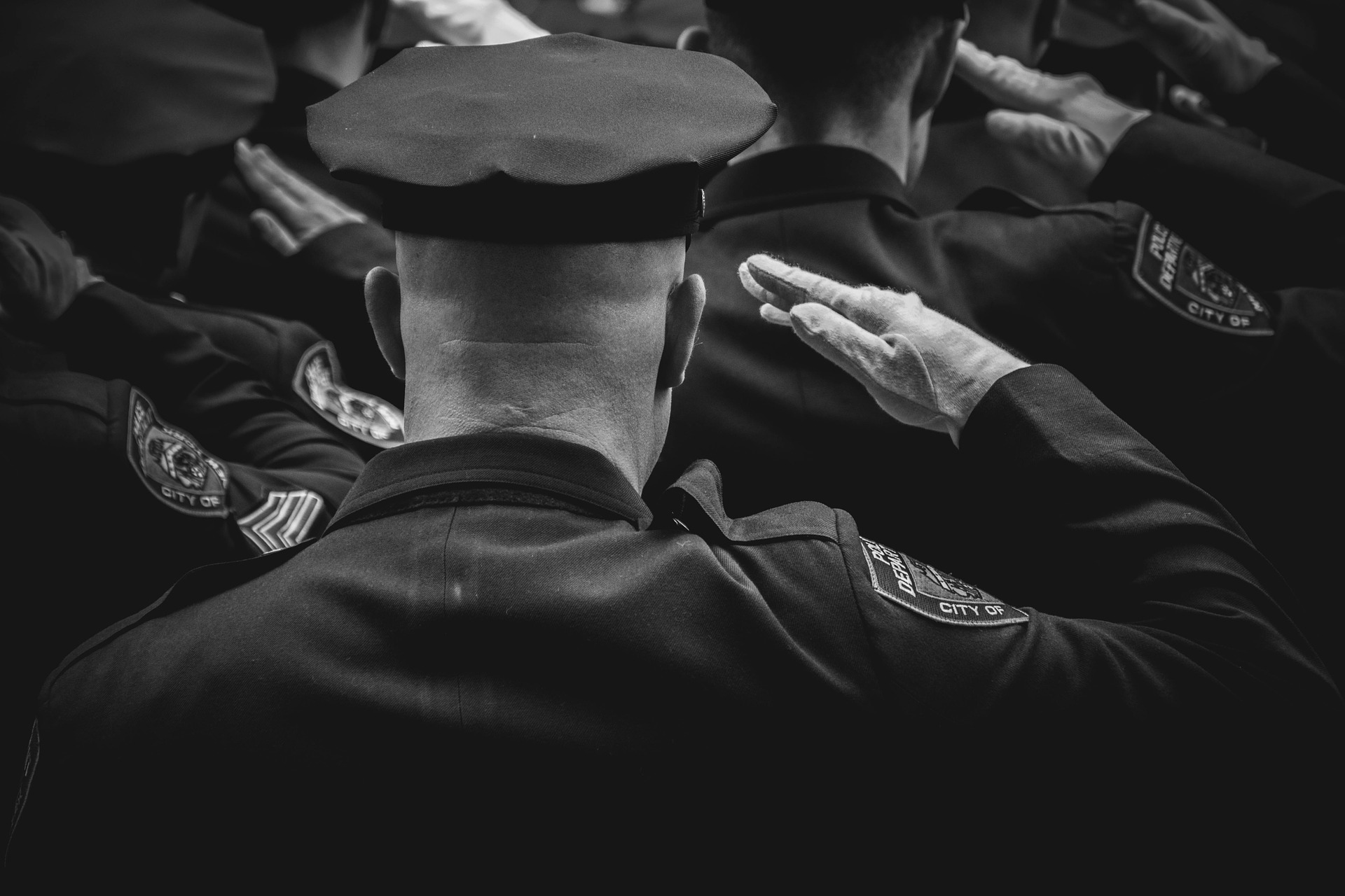 Police officers saluting.