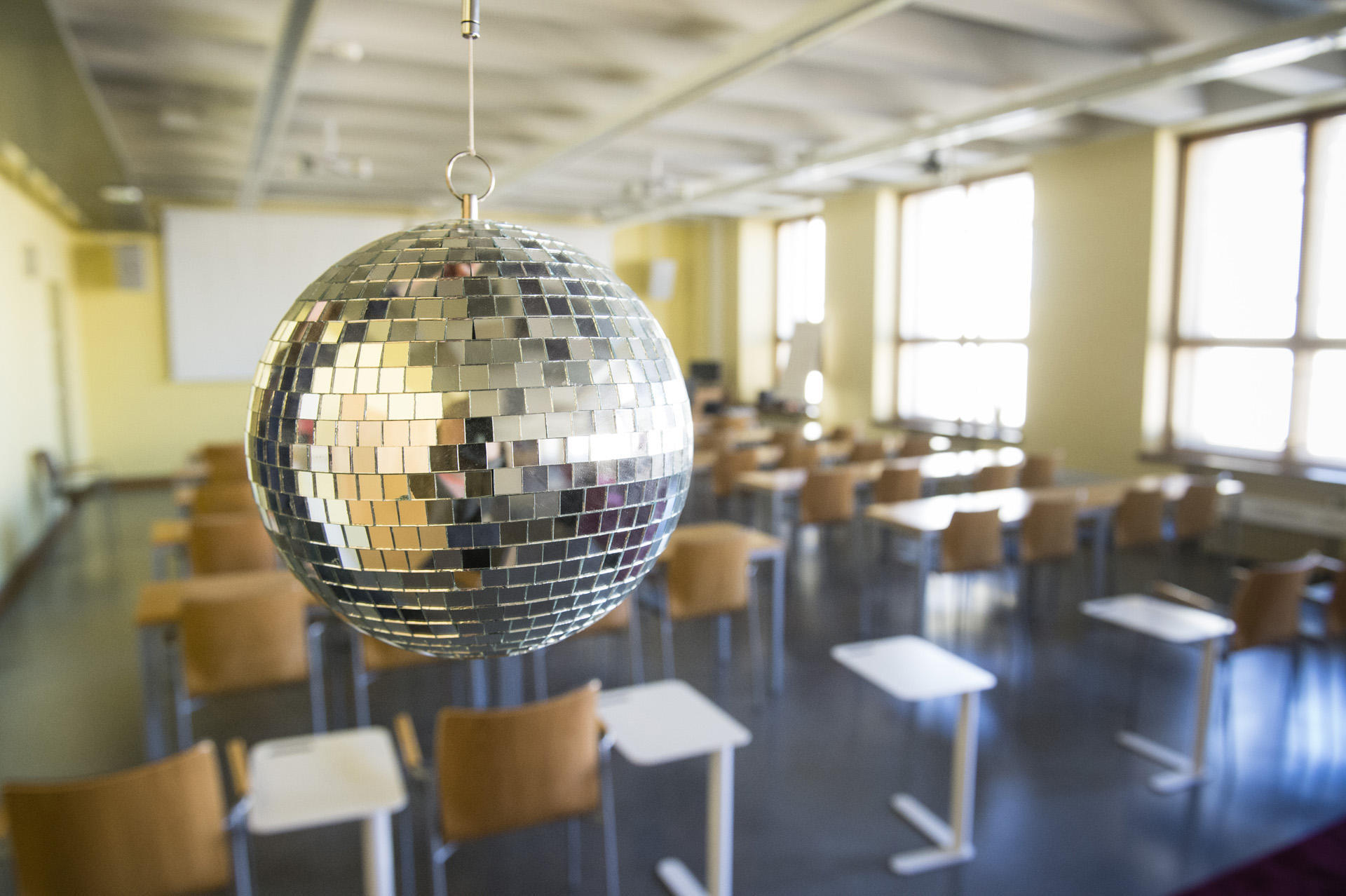A disco ball is hanging from the ceiling at the Collegium.