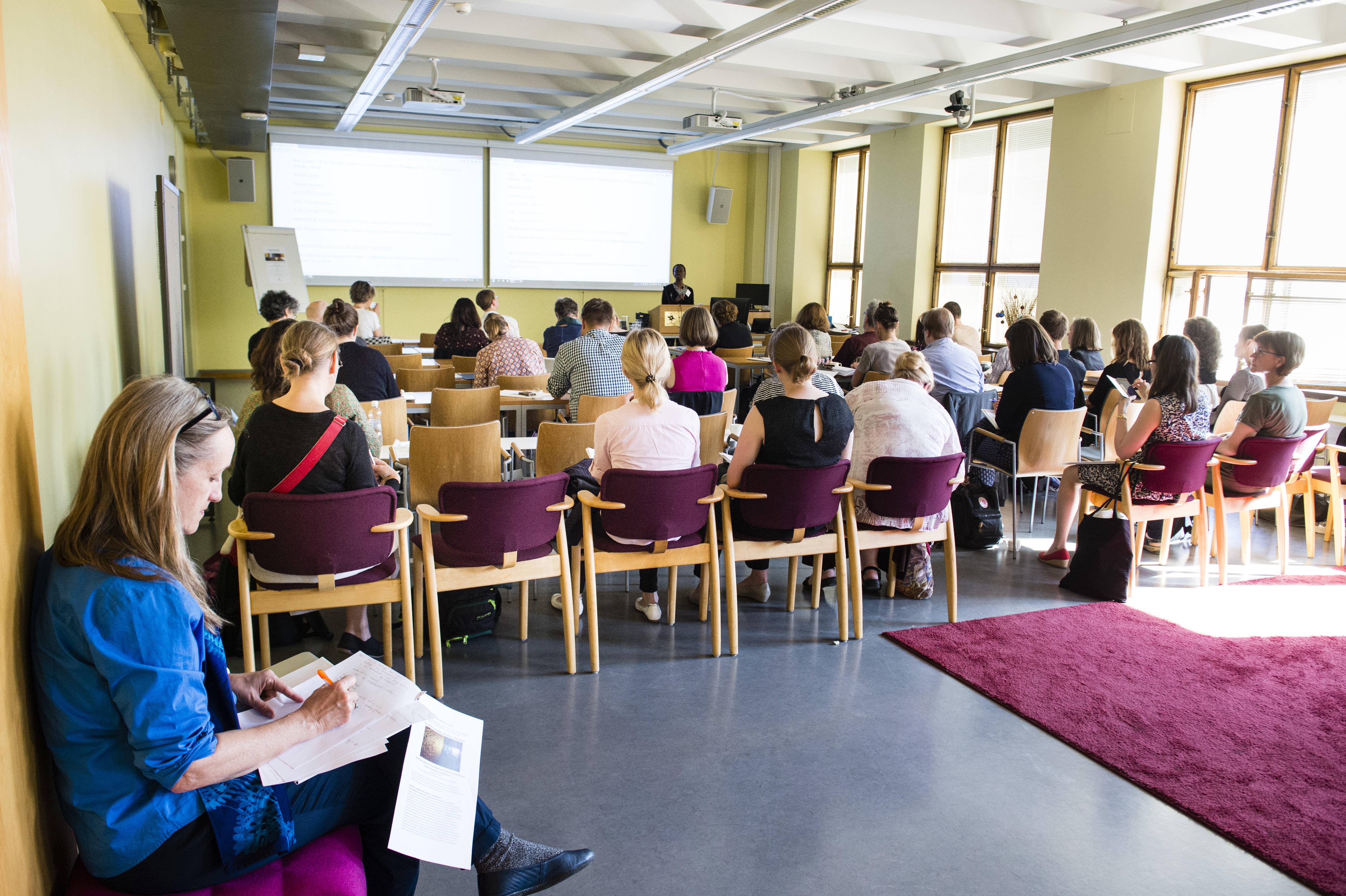 HCAS Common room full of participants following a presentation.