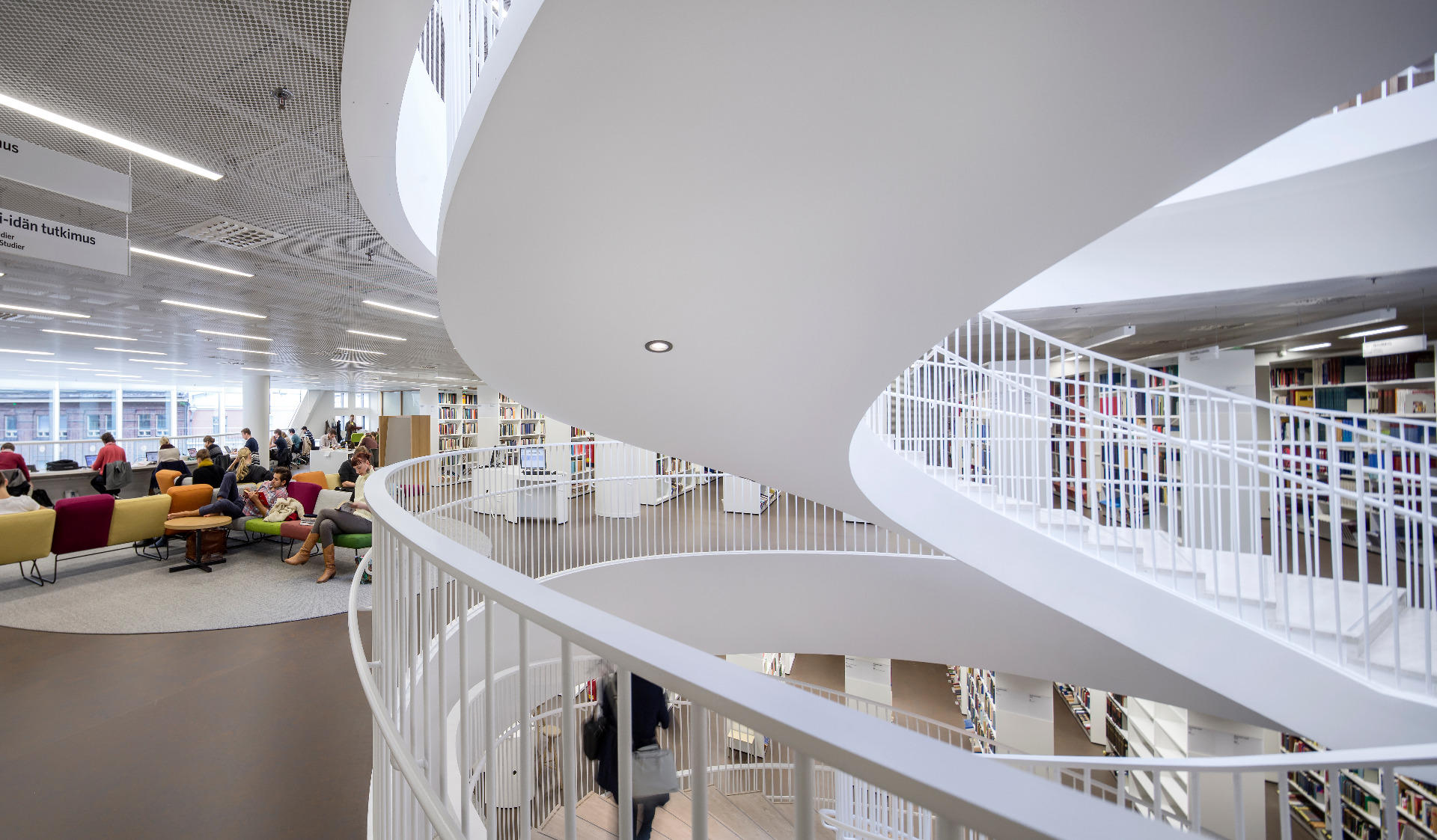 The staircase, books and students at the Kaisa House, the main library of the University of Helsinki.Photo by Mika Huisman.