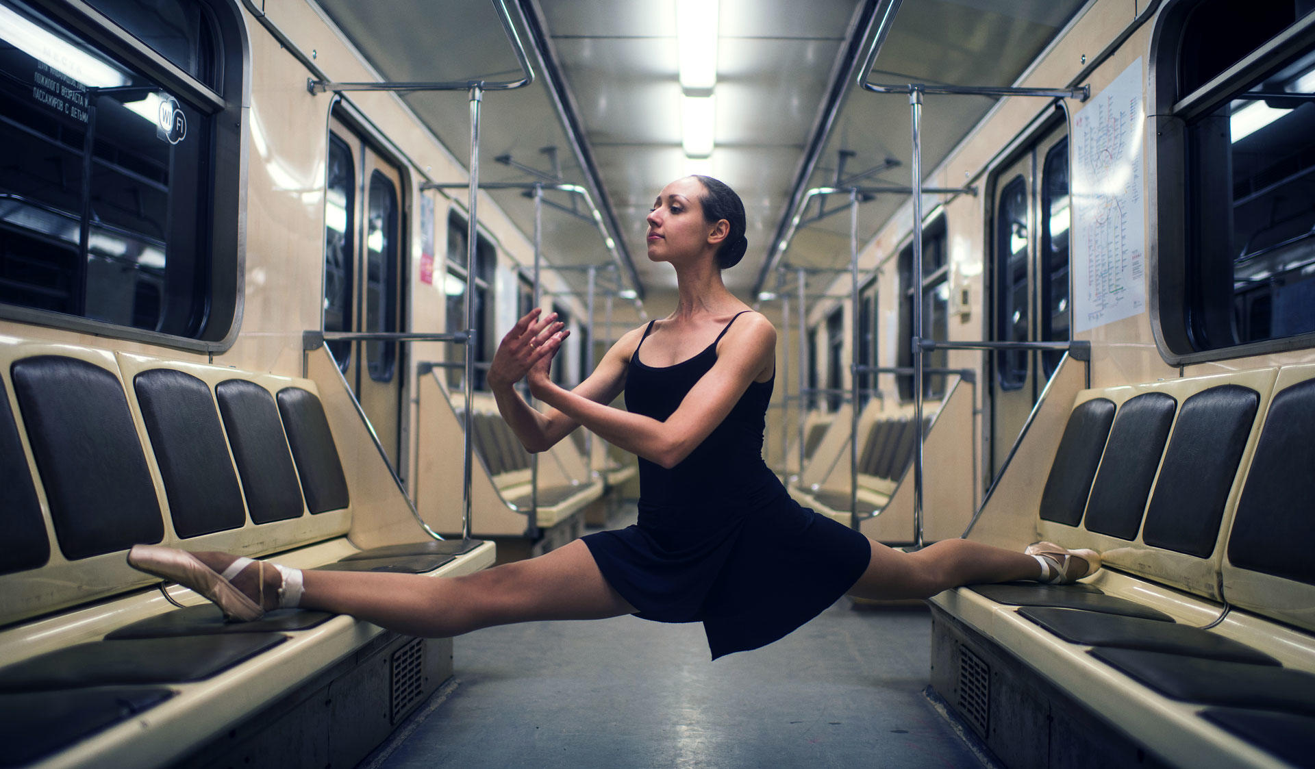 A ballet dancer making a split on the benches of an underground. Image of the Master's Programme in Russian Studies at the University of Helsinki.