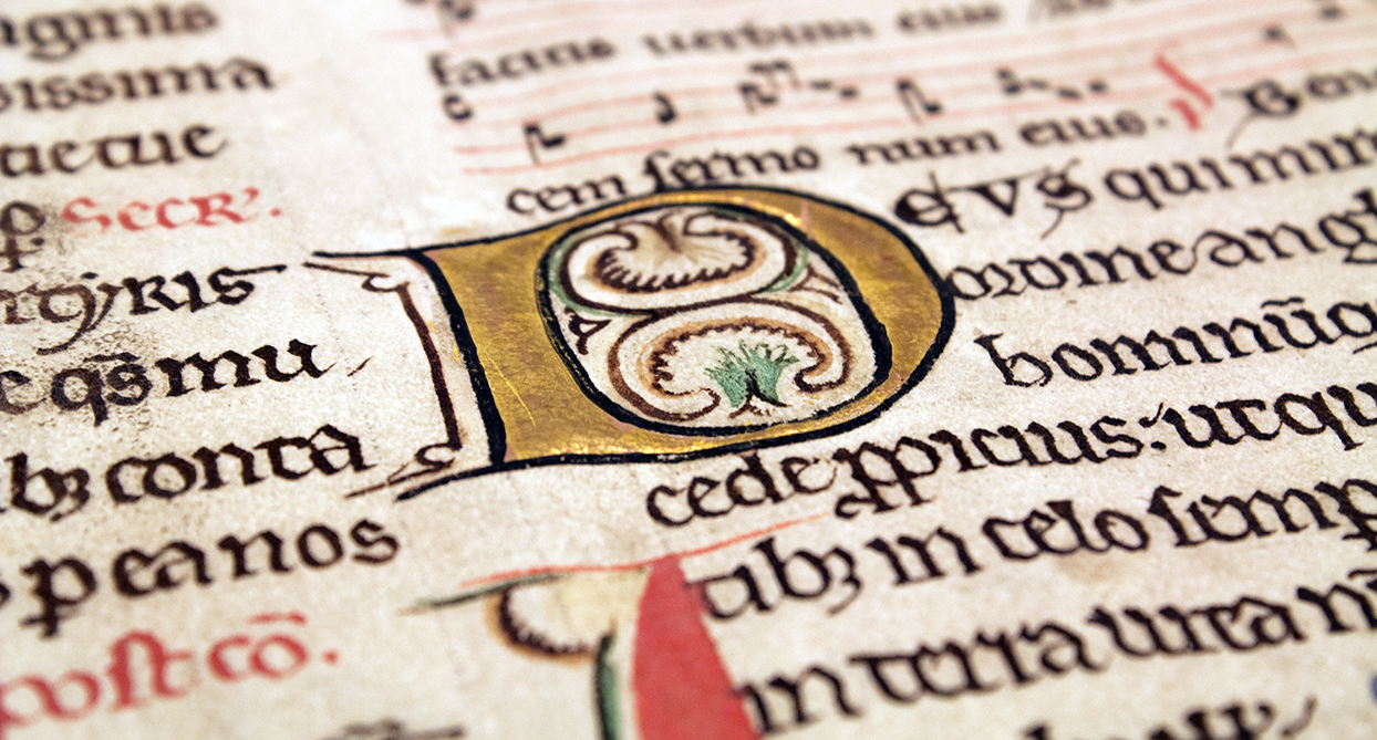 Initial D from a medieval manuscript.