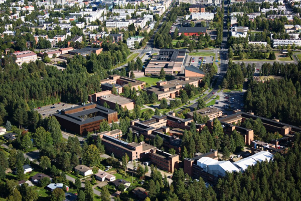 university campus building surrounded by forest