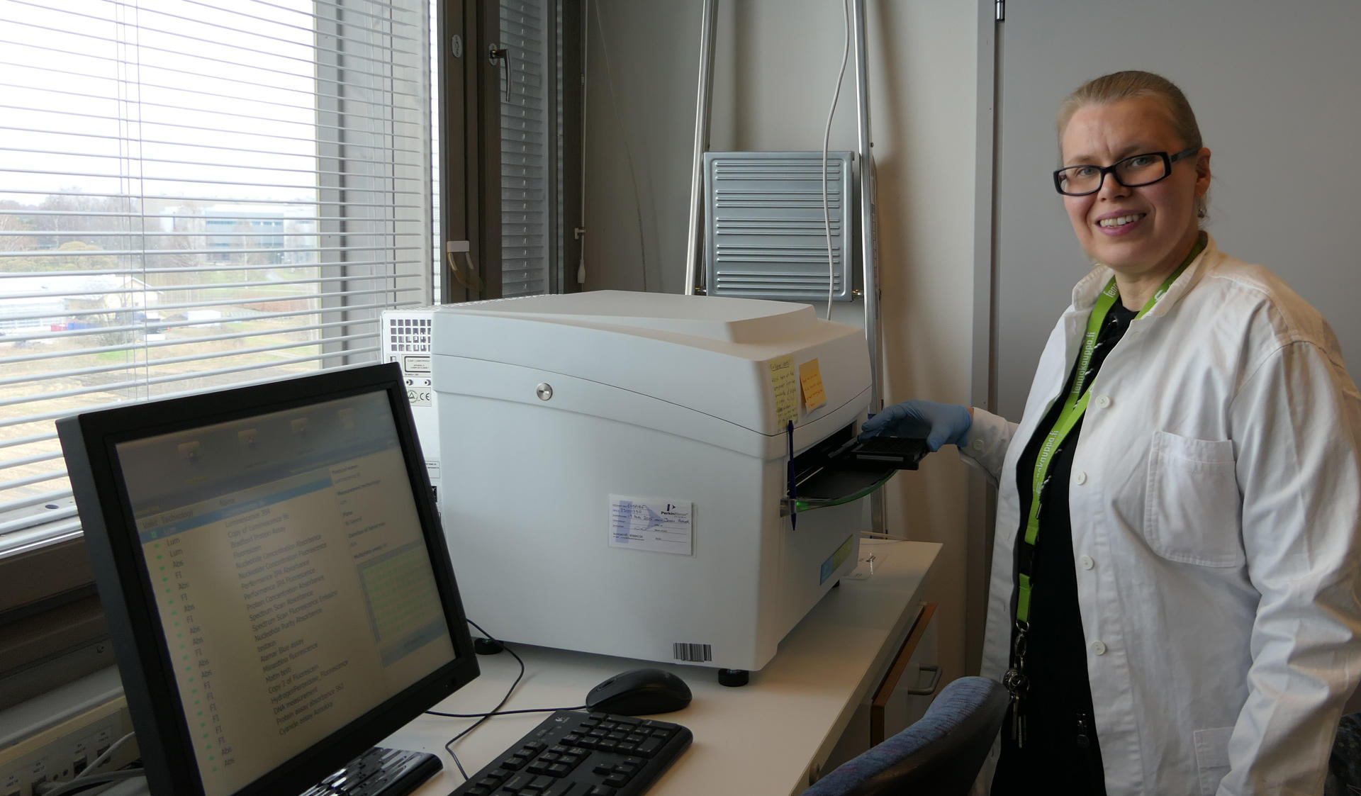 MES Labs coordinator Kirsi Kähkönen is happy to use multimode plate reader to measure DNA consentrations.
