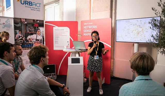Yu-Yi Huynh, a student in Urban Studies and Planning, talking at an event.